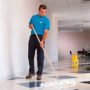 Man mopping a floor